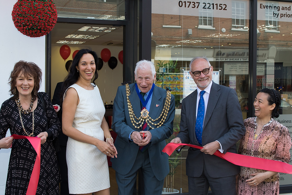 Ribbon cutting ceremony outside Newmans in Reigate